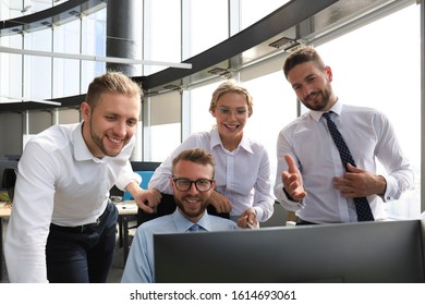 Group of young modern people in formalwear using modern technologies while working in the creative office - Shutterstock ID 1614693061