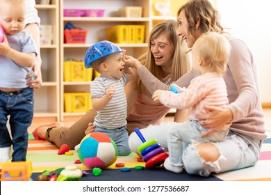 Group of young moms with their babies at playgroup