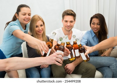 Group Of Young Multi-ethnic Friends Toasting Beer Bottles