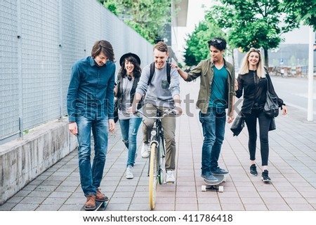 group young multiethnic friends walking down stock photo edit now