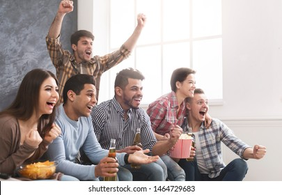 Group Of Young Multiracial Friends Watching Sports On Television And Cheering, Copy Space