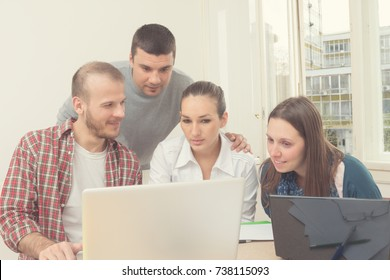 Group of young ordinary people working in the office.
