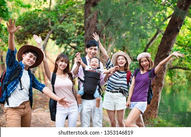 Group of young people with backpacks hiking together