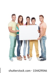 Group of young people with a blank placard isolated on a white background