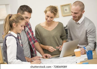 group of young people in business meeting