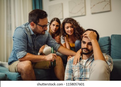 Group of young people comforting their upset friend while discussing problems at home