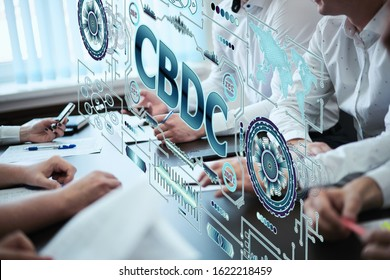A group of young people discuss the concept of central bank digital currency. Holographic futuristic screen with the inscription CBDC - Shutterstock ID 1622218459