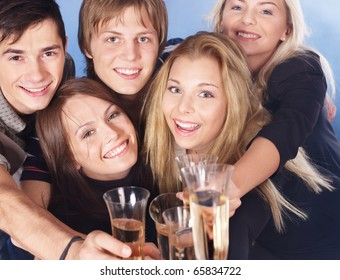 Group young people drink champagne.