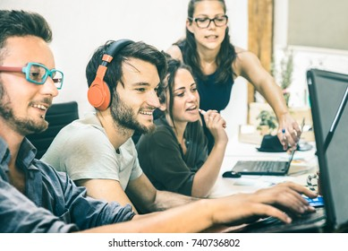 Group of young people employee workers with computer in startup studio - Human resource business and teamwork concept on laptop working time - Start up entrepreneurs at office - Teal and orange filter