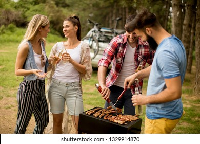 Group of young people enjoying barbecue party in the nature
