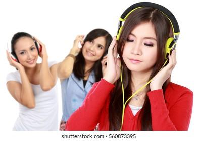 group of young people enjoying music with headphones