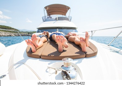group of young people enjoying a yacht holiday in the sea