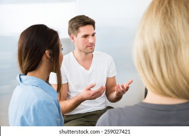 Group Of Young People Having Conversation