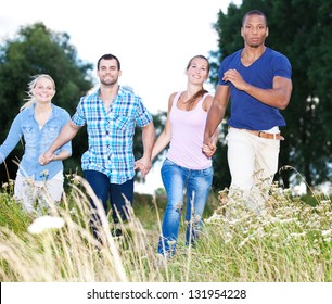 Group of young people having fun in nature