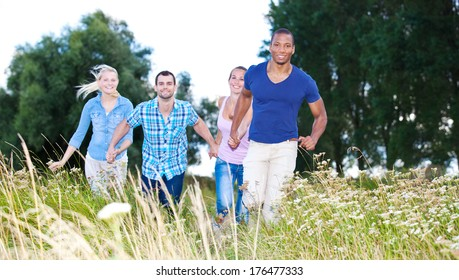 Group of young people having fun outside