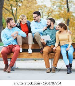 Group of young people having fun outdoors in a park