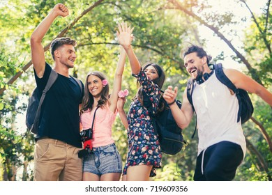 Group of young people having fun in summer park