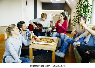 Group of young people having a party in the house