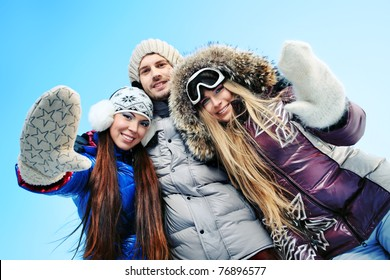 Group of young people having a rest outdoor in winter.