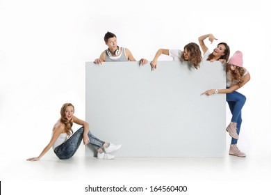 Group of young people holding an empty white board with space for text