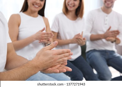 Group of young people learning sign language with teacher indoors, closeup