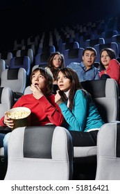 Group of young people look a film at a cinema