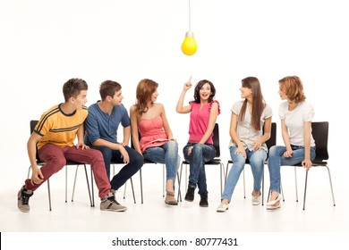 group of young people looking amazed at girl having an idea