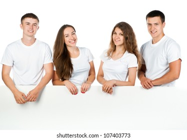 Group of young people looking out white board.