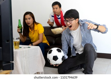 Group of young people man and woman watch Football match on tv broadcast program