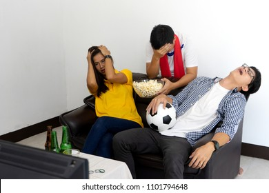Group of young people man and woman watch Football match on tv broadcast program but game match are lose so disappointment