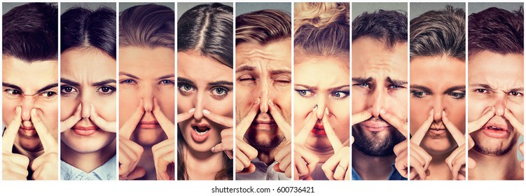 Group of young people men and women pinching nose with fingers look with disgust something stinks bad smell. Human face expression reaction