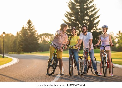Group of young people on a bike trip. Group of joyful students on a bike ride. Spending qualitative time together.