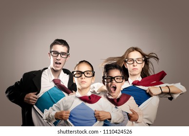 group of young people opening their shirt like superheros on a gray background