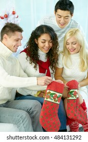Group of young people Preparing Christmas stockings for holiday