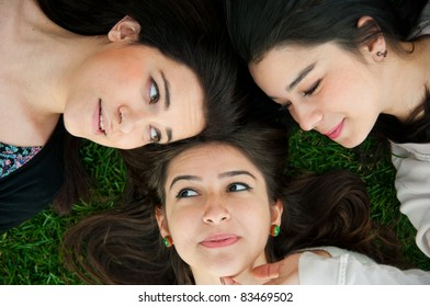Group of young people relaxing and lying on the grass