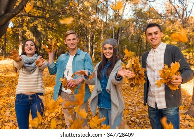 Group of young people students while walking autumn park