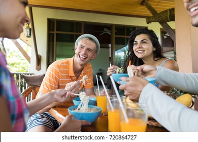 Group of Young People Talking While Eating Noodles Soup Traditional Asian Food Friends Dining Together Relationship And Communication Concept