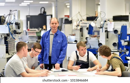 Group of young people in technical vocational training with teacher