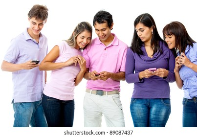 Group of young people texting on their cell phones - isolated over a white background