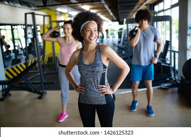 Group of young people training in gym