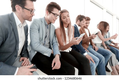 group of young people use their smartphones