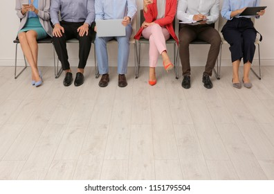 Group of young people waiting for job interview on chairs