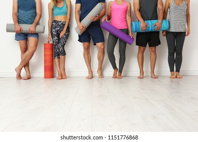 Group of young people waiting for yoga class