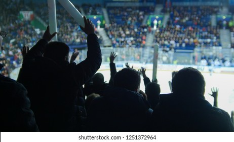 A group of young people watching hockey match. Ovation