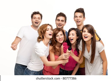group of young pople having fun at karaoke