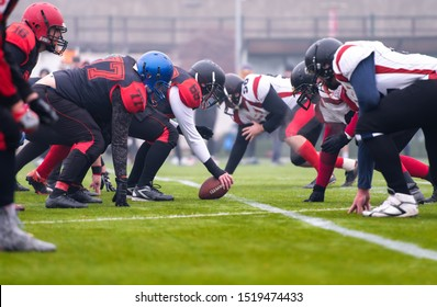 group of young professional american football players ready to start during training match on the stadium field
