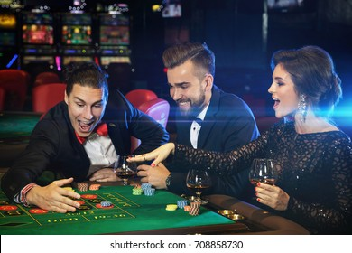 Group of young rich people playing roulette in the casino