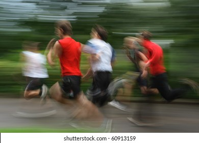 Group of young runners in moving. shooting with long exposure for blur effect.unrecognizable faces