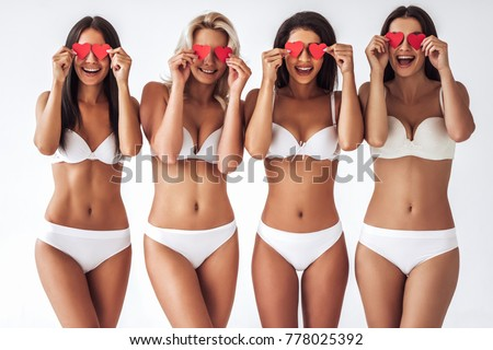 6f371fb0ec Group of young sexy multiracial women in white lingerie are posing on white  background with red