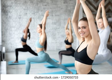 Group of young sporty woman practicing yoga together. Working out.